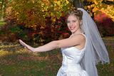 Autumn Bride smiling after looking at her rings.