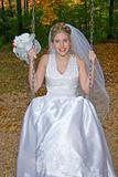 Autumn Bride on swing set in park.