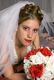 Autumn Bride with bouquet and leafs laying on her bed.