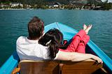 young couple boating on the lake