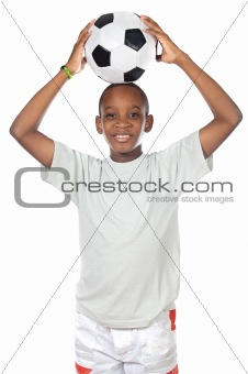 boy holding a soccer ball
