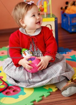 Portrait of cute baby with toy