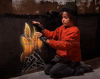 Flames of hope - homeless boy warming