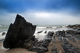 Landscape seascape of jagged and rugged rocks on coastline with