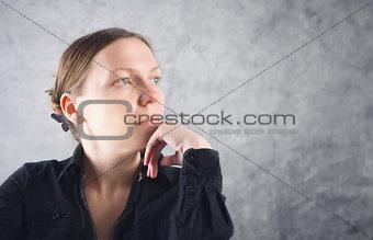 Portrait of beautiful woman thinking