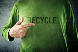 RECYCLE. Man pointing to title printed on his shirt