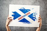 SCotland Independence flag. Man holding banner with Scotish inde