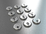 Metallic pay phone keypad.