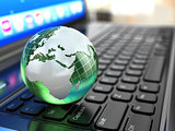 Global communications. Earth on laptop keyboard.