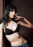 Sexy young girl smoking cigarette