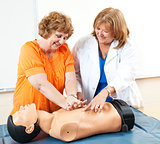 Mature Woman Learning CPR