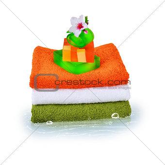 Three towels and natural soap
