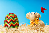 Easter egg and easter lamb in hay