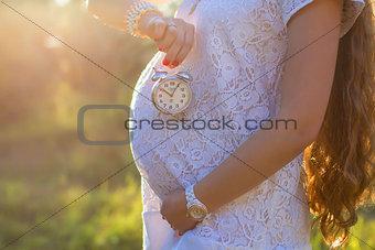 Pregnant girl in nature