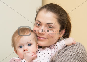 Portrait of young mother with the baby.