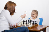 Mother explains how to play chess