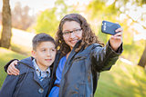 Brother and Sister Taking Cell Phone Picture of Themselves