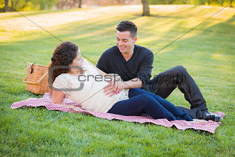 Pregnant Hispanic Couple in The Park Outdoors