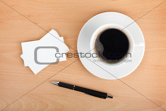 Blank business cards with coffee cup and pen