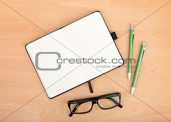Blank notepad and office supplies