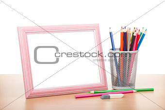 Blank photo frame and colorful pencils