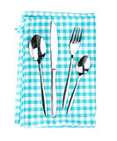 Silverware or flatware set of fork, spoons and knife over kitche