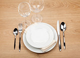 Empty plate, glasses and silverware set
