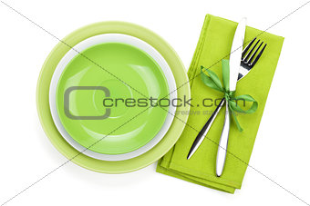 Fork with knife over towel and empty plates