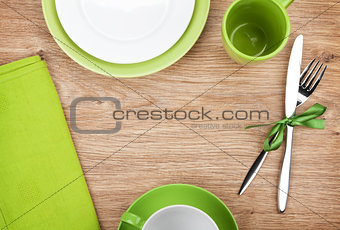 Kitchen utensils over wooden table