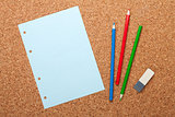Blank notepad page on cork notice board