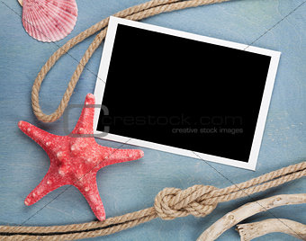 Blank photo frame with seashells, ship rope, sea stones