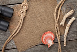 Ship rope with burlap on old wooden texture background