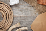 Ship rope on old wooden texture background