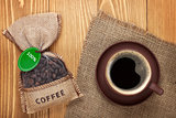 Coffee cup and small bag with beans