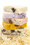 Pile of handmade soap in nest \ isolated on white