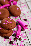 chocolate cookies, coffee beans, pink ribbons and confetti