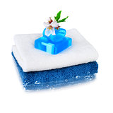 White and blue towels with blue soap