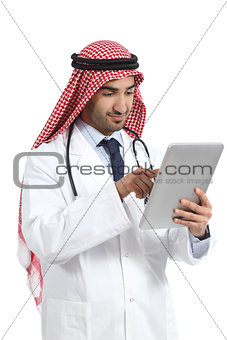 Arab saudi emirates doctor man browsing a digital tablet