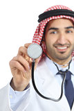 Arab saudi emirates doctor man using a stethoscope to the camera