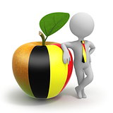 Apple with Belgium flag and businessman