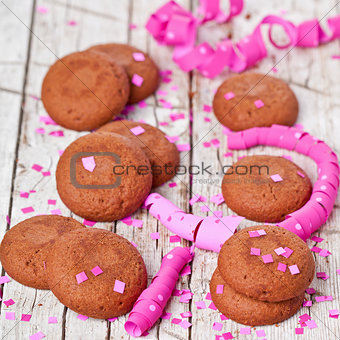 fresh chocolate cookies, pink ribbons and confetti