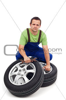 Car mechanic with new tires