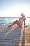 Attractive woman sitting on pier