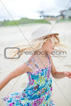 Cute young girl having fun at beach