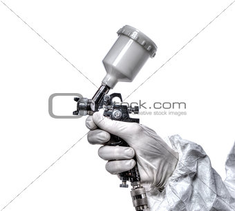 Worker with airbrush gun