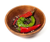 Various of hot peppers in wooden plate