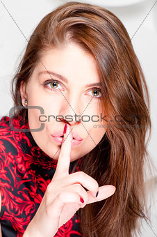 Beautiful woman shows that you need to keep quiet
