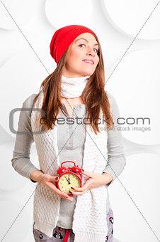 beautiful smiling woman holding alarm clock