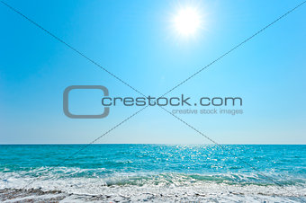 bright sun over blue sea