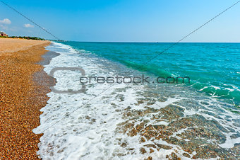 sandy beach and turquoise sea water